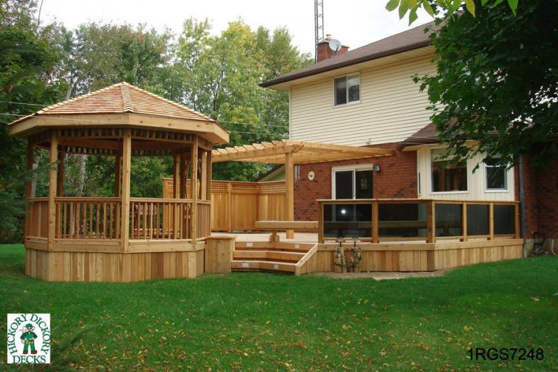 1 Level Deck With A Spa Pergola Bench Planters