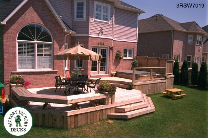 ... Three Level Deck With A Spa, Privacy Screen, Bench, Planters (