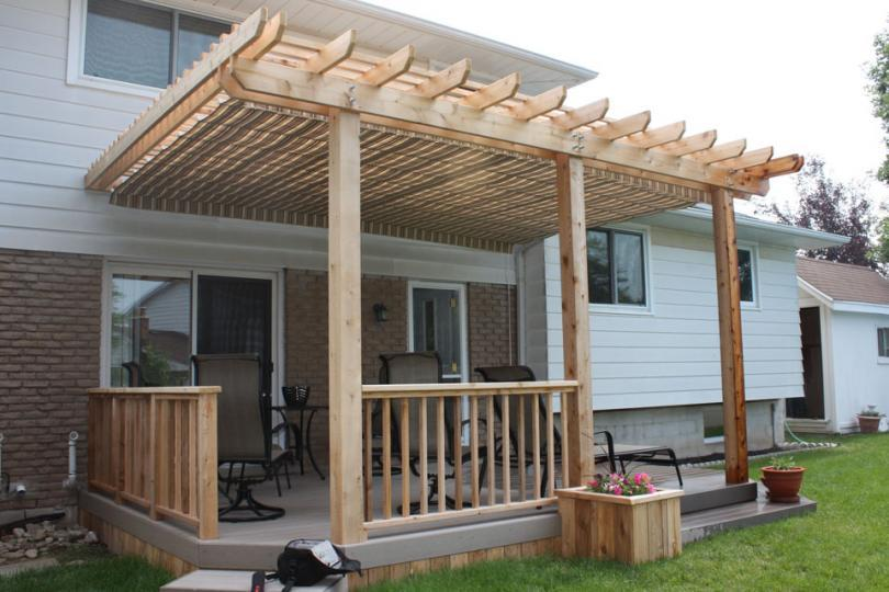 Medium size, low, single level deck design with planters and a pergola. - Pergola DIY Deck Plans