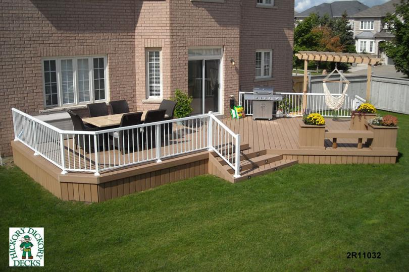 Very large, 2-level deck with planters and benches (#2R11032).